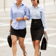Two businesswoman are walking on the street — Stock Photo #31511599
