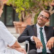 Smiling Businessman on wheelchair looking towards his doctor — Stock Photo