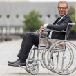 Businessman on wheelchair — Stock Photo