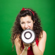 Young woman screaming through megaphone — Stock Photo