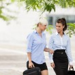 Two businesswoman are walking on the street — Stock Photo #32086097