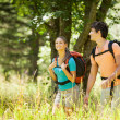 Couple is doing trekking in the woods — Stock Photo #32087241
