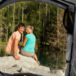 View of a couple that camps from the inside of a tent — Stock Photo #32087611