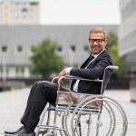 Businessman on wheelchair — Stock Photo #32087807