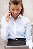 Brunette businesswoman is phoning — Stock Photo