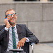 Businessman on wheelchair is phoning — Stock Photo
