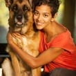 Smiling woman is hugging her german shepherd — Stock Photo