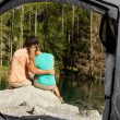 View of a couple that camps from the inside of a tent — Stok fotoğraf