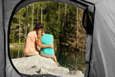 View of a couple that camps from the inside of a tent — Stock Photo