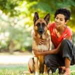 Portrait of woman with german shepherd — Stock Photo #34495777