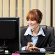 Stock Photo: Female support assistant working at helpdesk