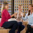 Three beautiful woman are celebrating their new business start — Stock Photo