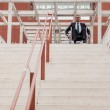 Businessman on wheelchair in front of stairs — Stock Photo #34496275
