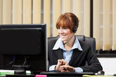 Female support assistant working at the helpdesk — Foto Stock