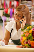 Florist is phoning — Stock Photo
