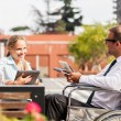 Stock Photo: Businessmon wheelchair talks to his colleague