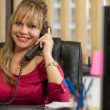 Businesswoman is phoning in the office — Lizenzfreies Foto