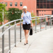 Businesswoman is walking while phoning — Stock Photo