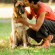 Portrait of woman with german shepherd — Stock Photo