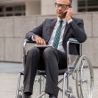 Businessman on wheelchair is phoning — Stock Photo #35754139