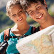 Closeup of couple in the mountains looking at the map — Stock Photo #35755253