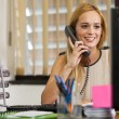 Stock Photo: Businesswoman is phoning in the office