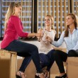 Stock Photo: Three beautiful woman are celebrating their new business start