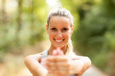 Portrait of gorgeous blond woman doing stretching exercises — Stock Photo