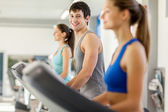 Happy young people on a treadmill — Stock Photo