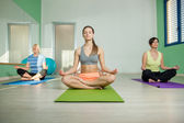 Group of woman are doing yoga exercises — Stock Photo