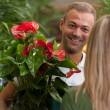 Stock Photo: Florist is consulting a customer