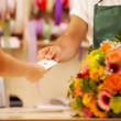 Woman is buying a colorful bouquet of flowers — Stock Photo #38647475