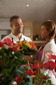Florist is consulting a customer — Stock Photo