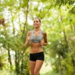 Beautiful blonde woman is doing running workout — Stock Photo