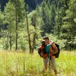 Couple is doing trekking in the woods — Stock Photo #39089711