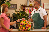 Woman is buying a colorful bouquet of flowers — Stock Photo