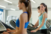 Happy young people on a treadmill — Foto de Stock