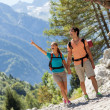 Couple is doing trekking in the mountains — Stock Photo #39327607