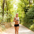 Stock Photo: Beautiful blonde woman is doing running workout