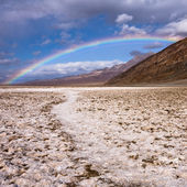 Rainbow over Badwater in Death Valley — Stock Photo