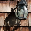 Old Lamp on a Wooden Wall with Shadow — Stock Photo #13168018