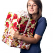 Woman holding a gift box — Stock Photo #12746120