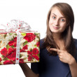 Woman holding a gift box — Foto de Stock
