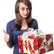 Woman holding a gift box — Stock Photo