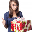 Woman holding a gift box — Stock Photo #12746388