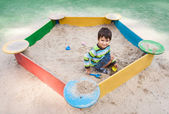 Boy playing in sandbox — Stock Photo