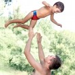 Father throwing his son — Foto de Stock