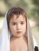 Three year old boy with a serious expression — Stock Photo