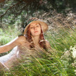 Young woman on natural background — Stock Photo