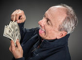Happy man with money — Stok fotoğraf